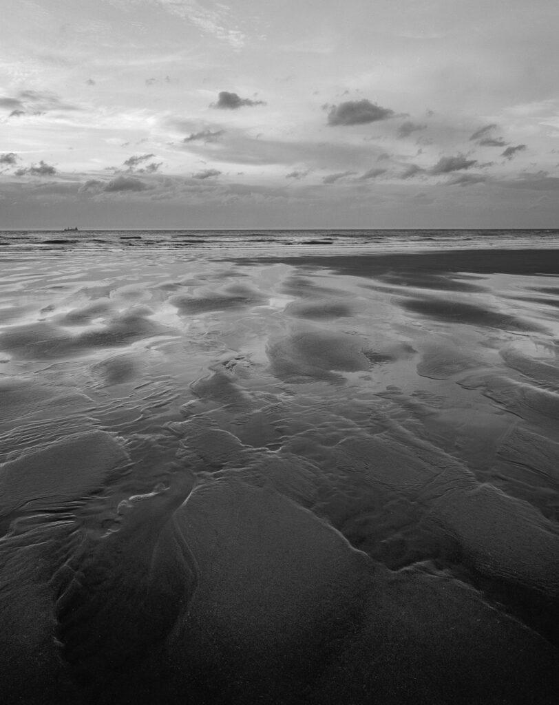 Strand met zee